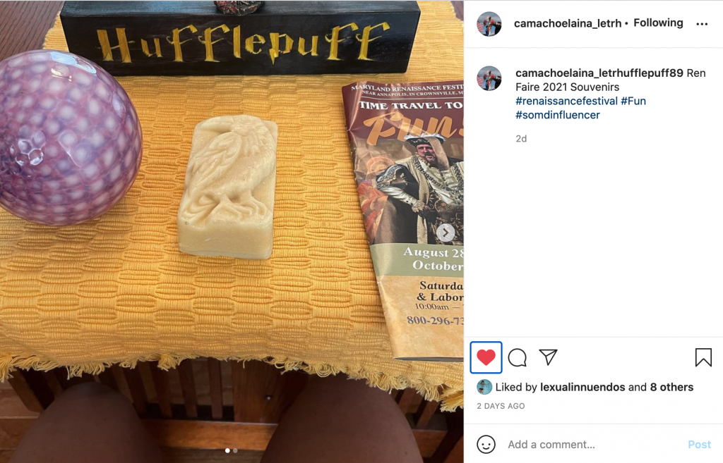Elaina Camacho posted on Instagram about the Renaissance festival that she just attended. Pictured is a dragon mold, ball, Hufflepuff sign, and booklet from the event