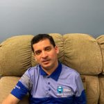 Athlete Leader, David Godoy sitting at home in his Athlete Leadership polo
